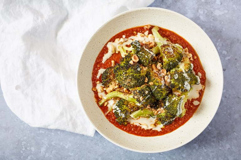 Roasted broccoli with hazelnut, tomato sauce and tahini