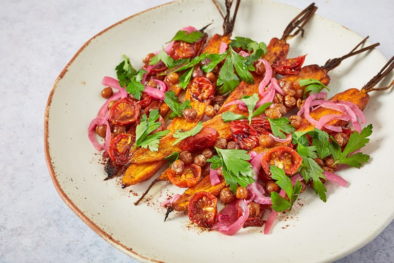 Roasted carrots and chickpeas with semi-dried tomatoes, pickled red onion, parsley and sumac dressing