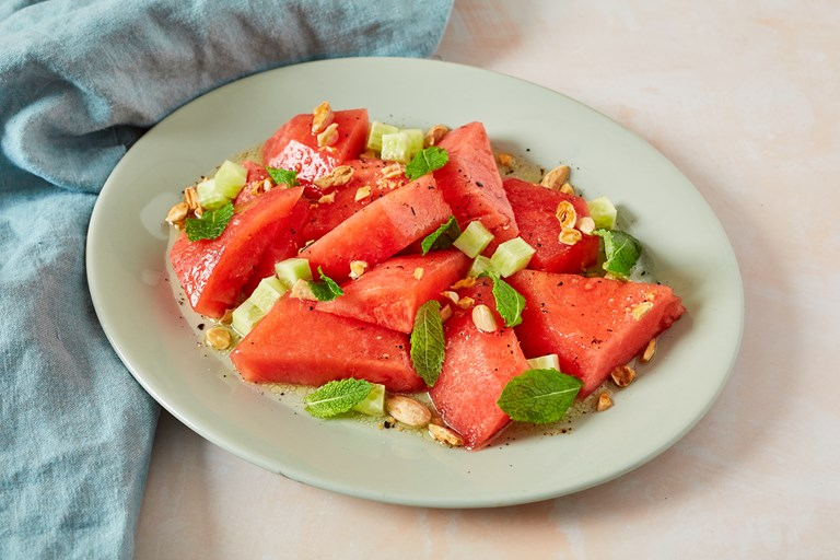Salted watermelon salad with mint, almond, cucumber and chilli