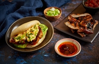 Char Siu pork belly 'breakfast' bao with egg, smoky tomato relish and coriander