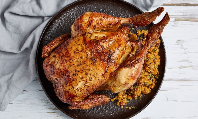 Rotisserie chicken with apricot, pine nut and freekeh stuffing