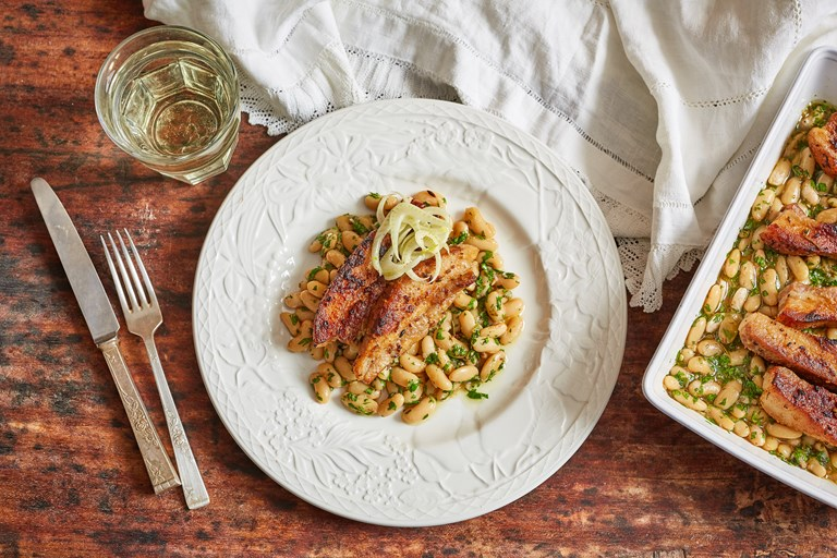 Pork belly with cannellini beans and salsa verde