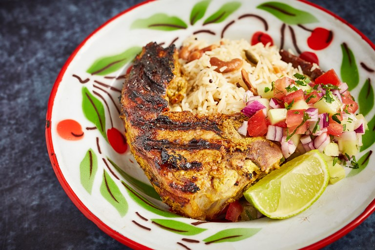Barbecued lamb chops with cashew pilaf and chopped salad