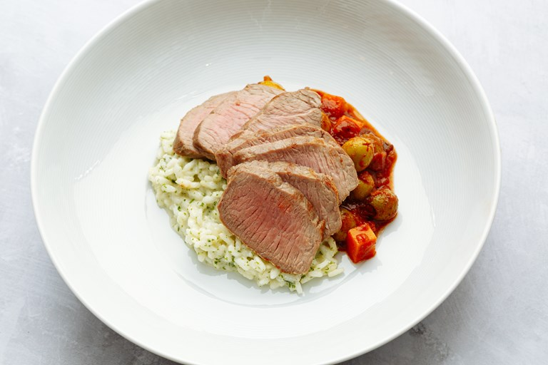 Lamb loin with sumac, lemon, olives and herb risotto