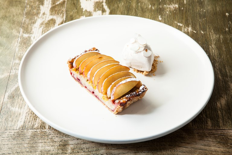 Plum and hazelnut tart with meadowsweet ice cream