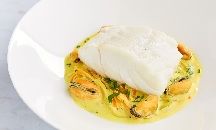 Steamed cod with curried mussels and carrots