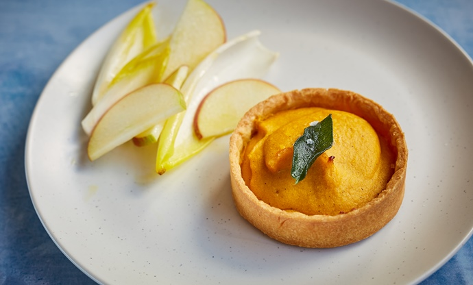 Curried squash tartlet with apple and chicory salad