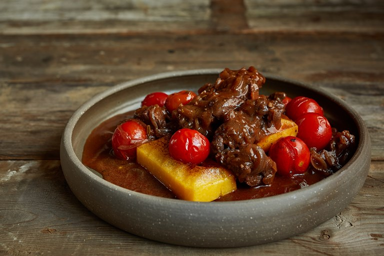 Venison, tomato and rosemary ragu with grilled polenta