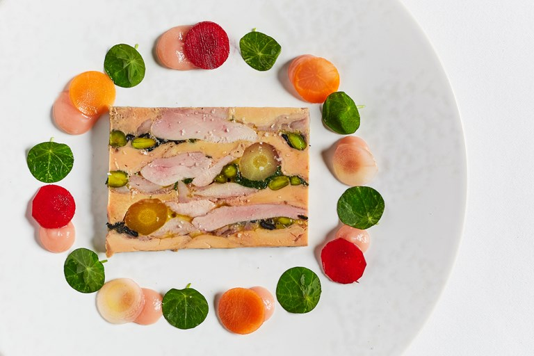 Mosaic of quail and foie gras with trompettes, pistachio, quince and carrot