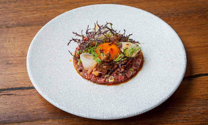 Beef tartare with soy-glazed egg yolk