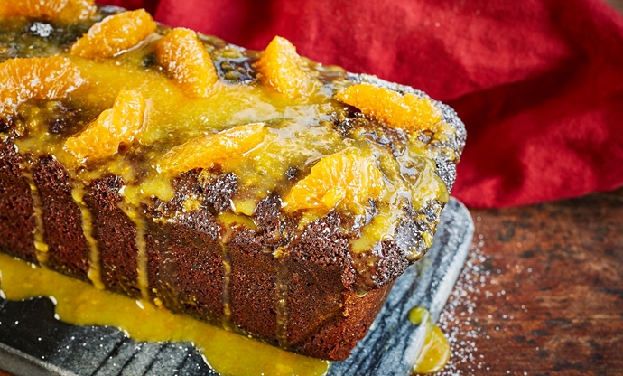 Spelt, ginger and treacle loaf with clementine icing