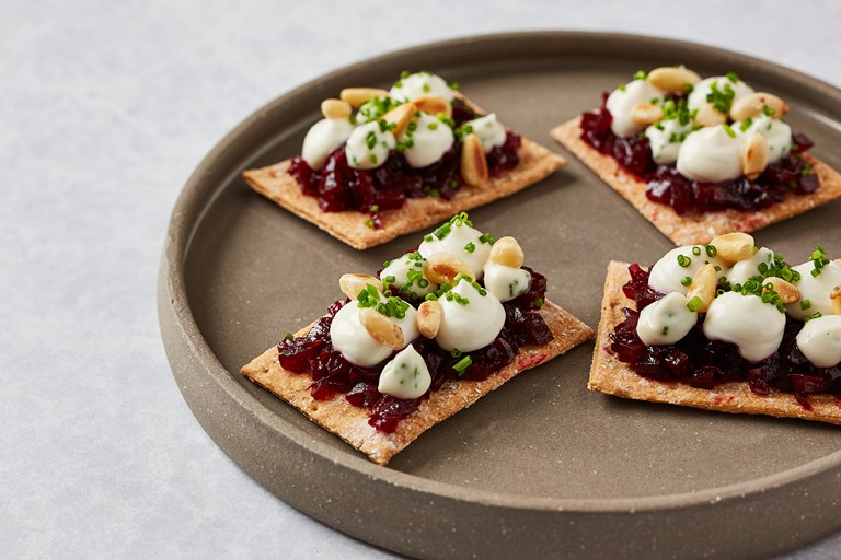 Beetroot, spiced candid pinenuts and smoked goats curd crispbreads