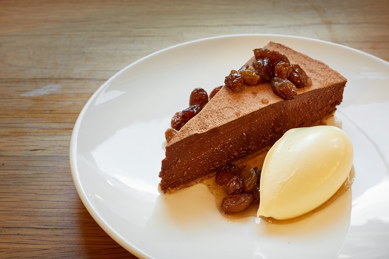 Chocolate tart with rum-soaked raisins and clotted cream