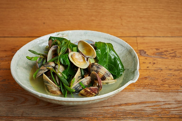 Butter and sake steamed clams with coastal greens