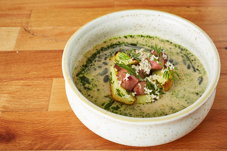 Sour rye soup with tongue, potatoes, dill and horseradish