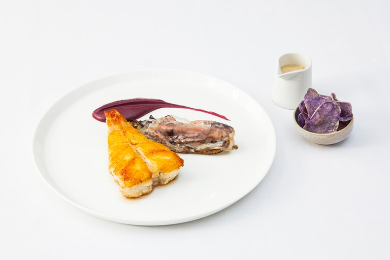 Roast turbot with red cabbage condiment, beer velouté and purple potato crisps