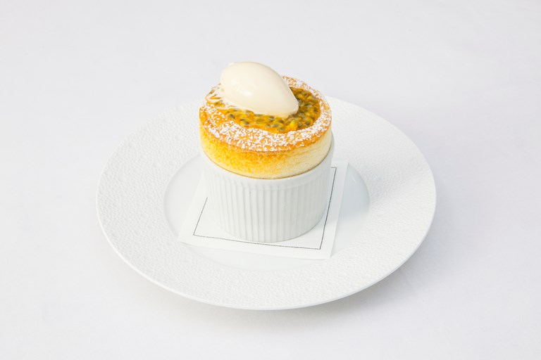Passion fruit soufflé with white chocolate ice cream