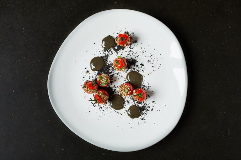Piccolo tomatoes stuffed with tapioca and black garlic