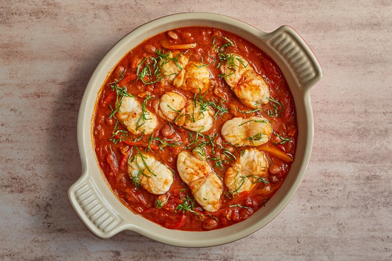 Monkfish with peppers, tomatoes and beans