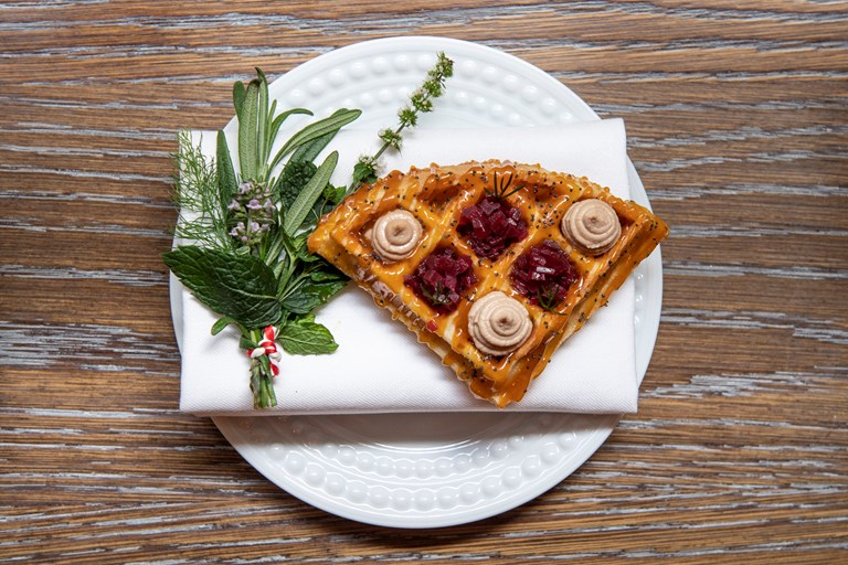 Waffles with chicken liver parfait and red wine shallots