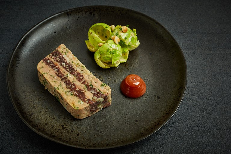 Black pudding and pork terrine with quince jam and truffled Brussels sprout salad