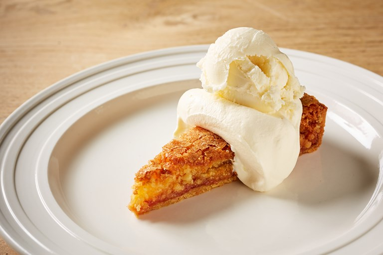 Quince tart with cream and ice cream