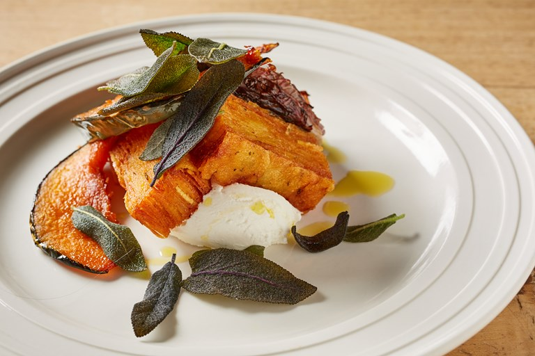 Potato pavé with goat's curd, pumpkin and crispy sage