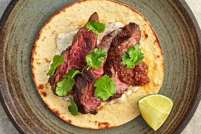 Beef onglet taco with spring onion crema, morita salsa and coriander