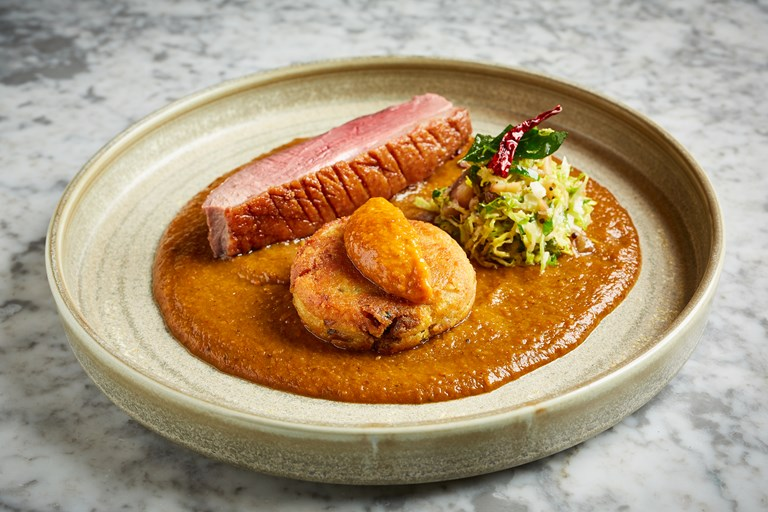 Goose vindaloo with confit leg aloo tiki, sprout and chestnut thoran and apple achaar