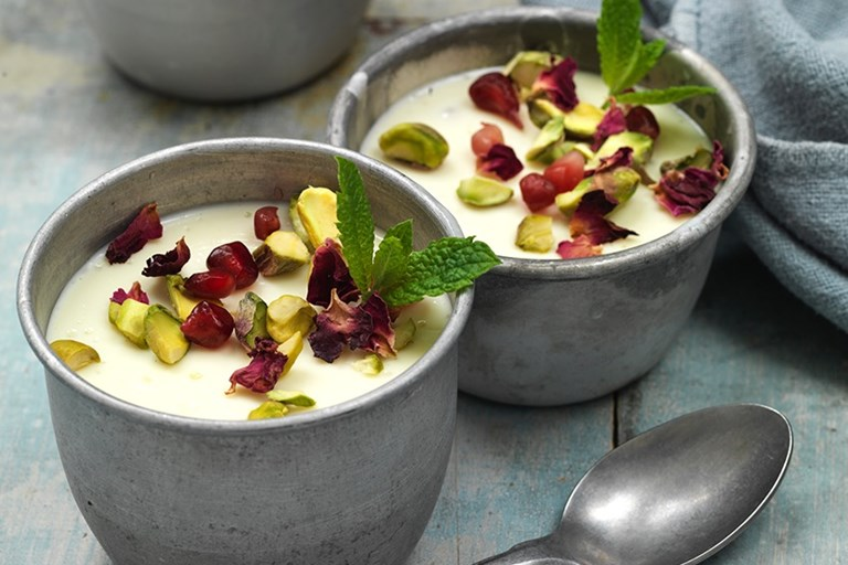 Mishti doi with pomegranate and mint