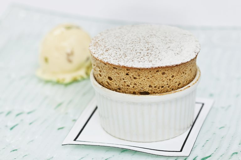 Prune and armagnac soufflé with tutti frutti ice cream