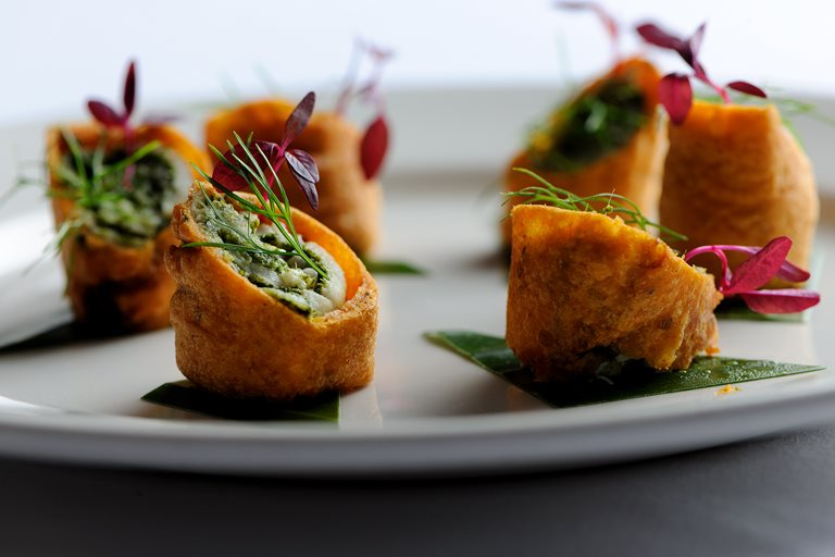 Tilapia and mint chutney rolls in a gram flour batter