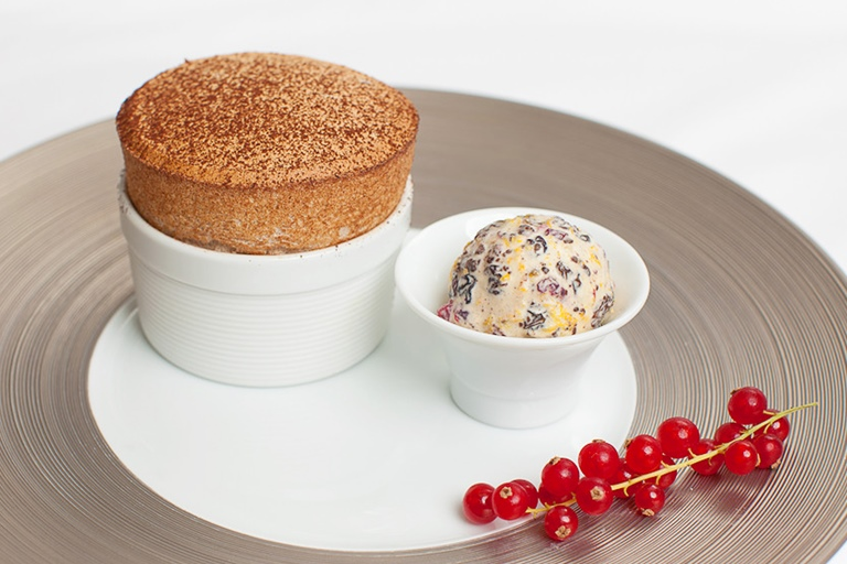 Dark chocolate soufflé with Christmas pudding ice cream and cinnamon sugar